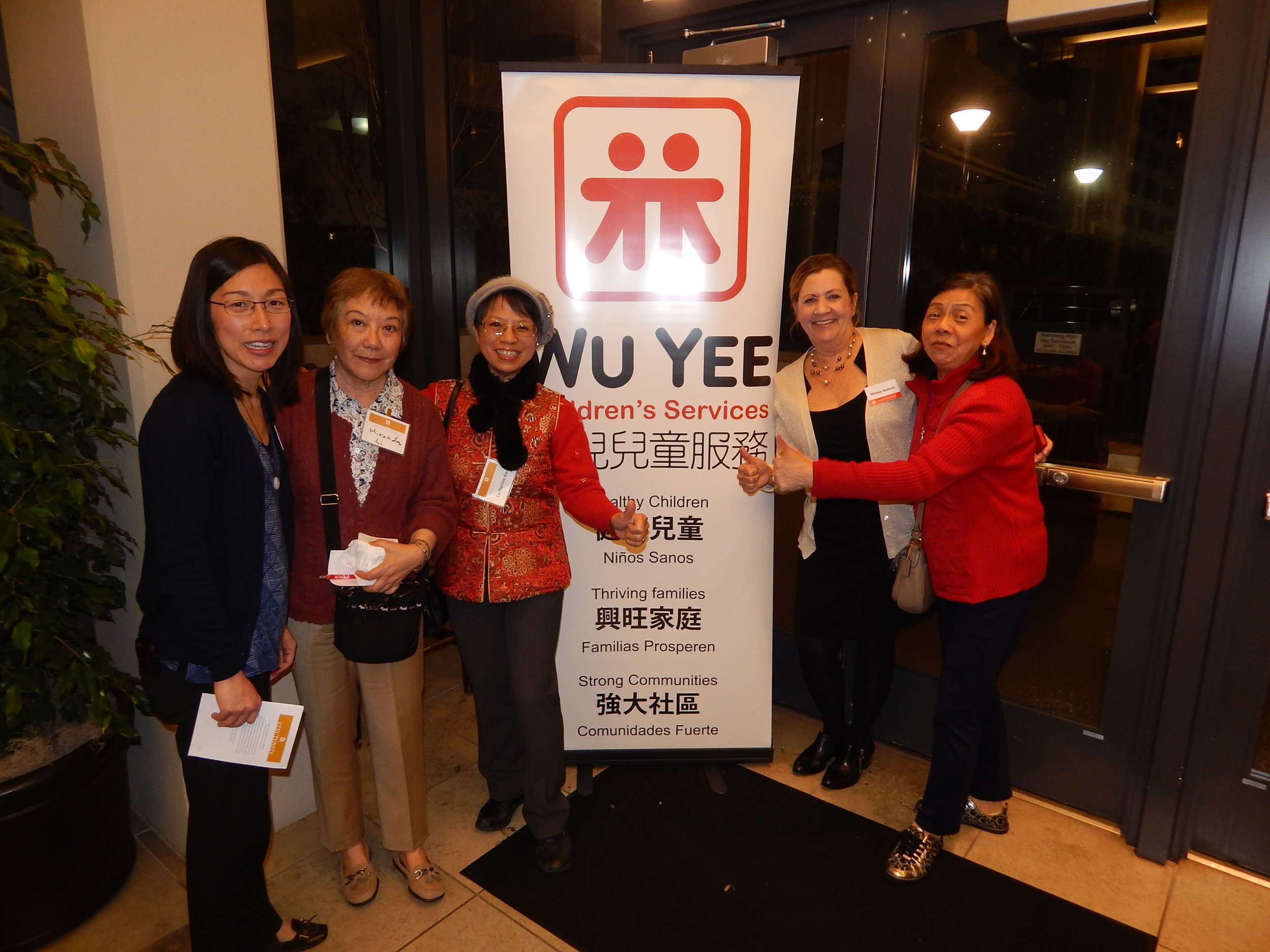 Wu Yee's Chief Programs Officer, Alyson Suzuki, and CEO, Monica Walters with some of the agency's founders the 2016 Board Reunion.
