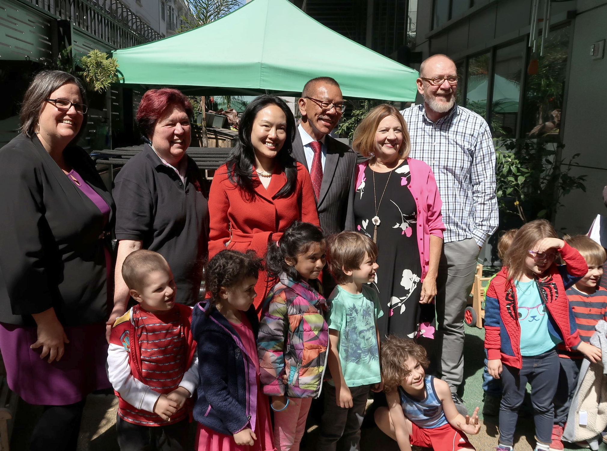 Left to right, September Jarrett, Executive Director of San Francisco Office of Early Care and Education, Bev Melugin, Chair of CPAC Quality Committee and Executive Director of C5 Children's School, Supervisor Jane Kim, Supervisor Norman Yee, Wu Yee CEO Monica Walters and Graham Dobson, Senior Policy Analyst of San Francisco Office of Early Care and Education with children from C5 Children's School.