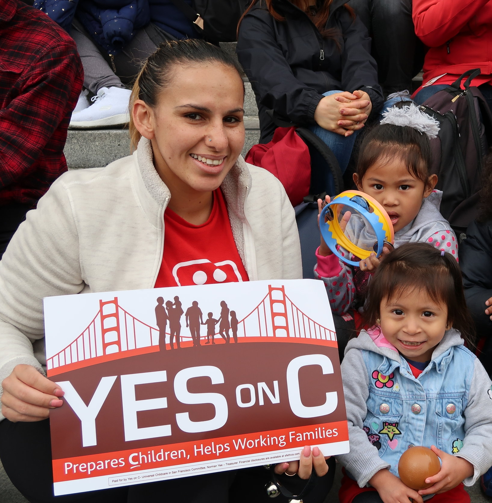 Wu Yee teacher, Dolores Leon with Wu Yee children at on the steps of SF City Hall during 2018 Walk Around the Block ECE rally.