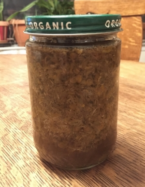 infusing herbs in an old peanut butter jar