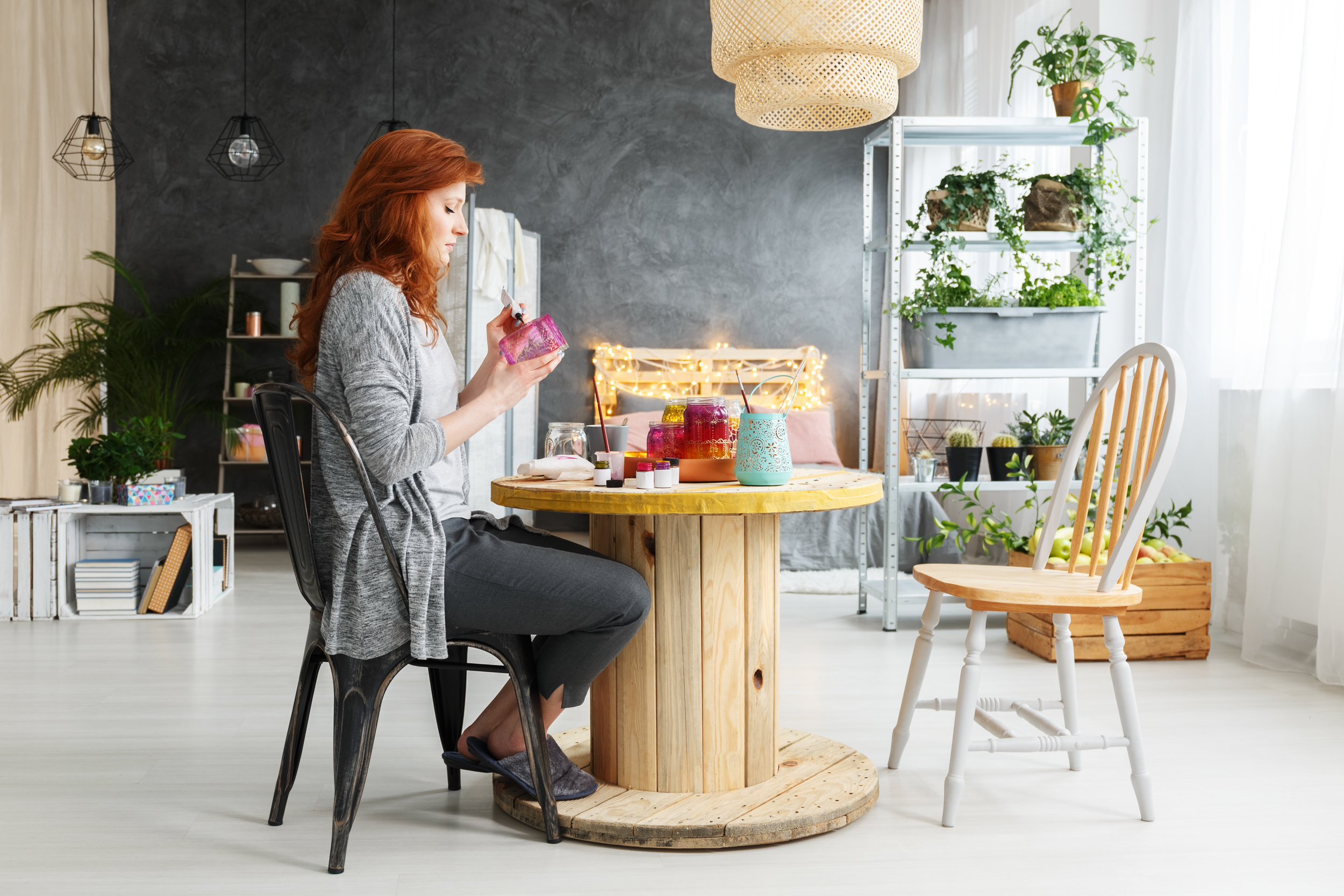 woman-making-craft-in-apartment-P48PCNT.jpg