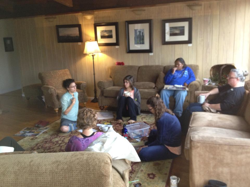Women learning, growing, sharing in a small break out group at a past retreat