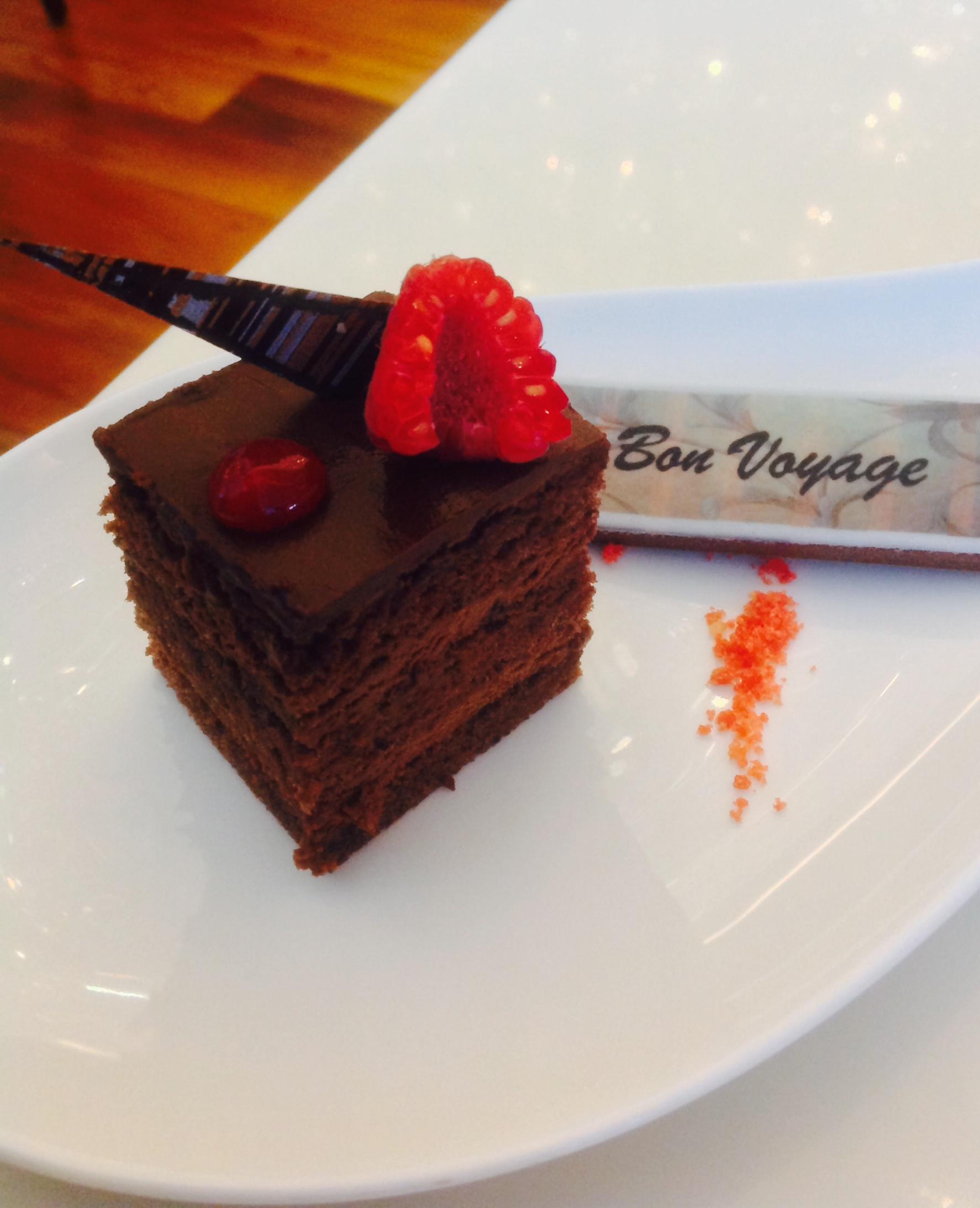 """Our """"bon voyage"""" mousse cake delivered to us at 8am- finished by 8.01am- it would have been rude not to!"""