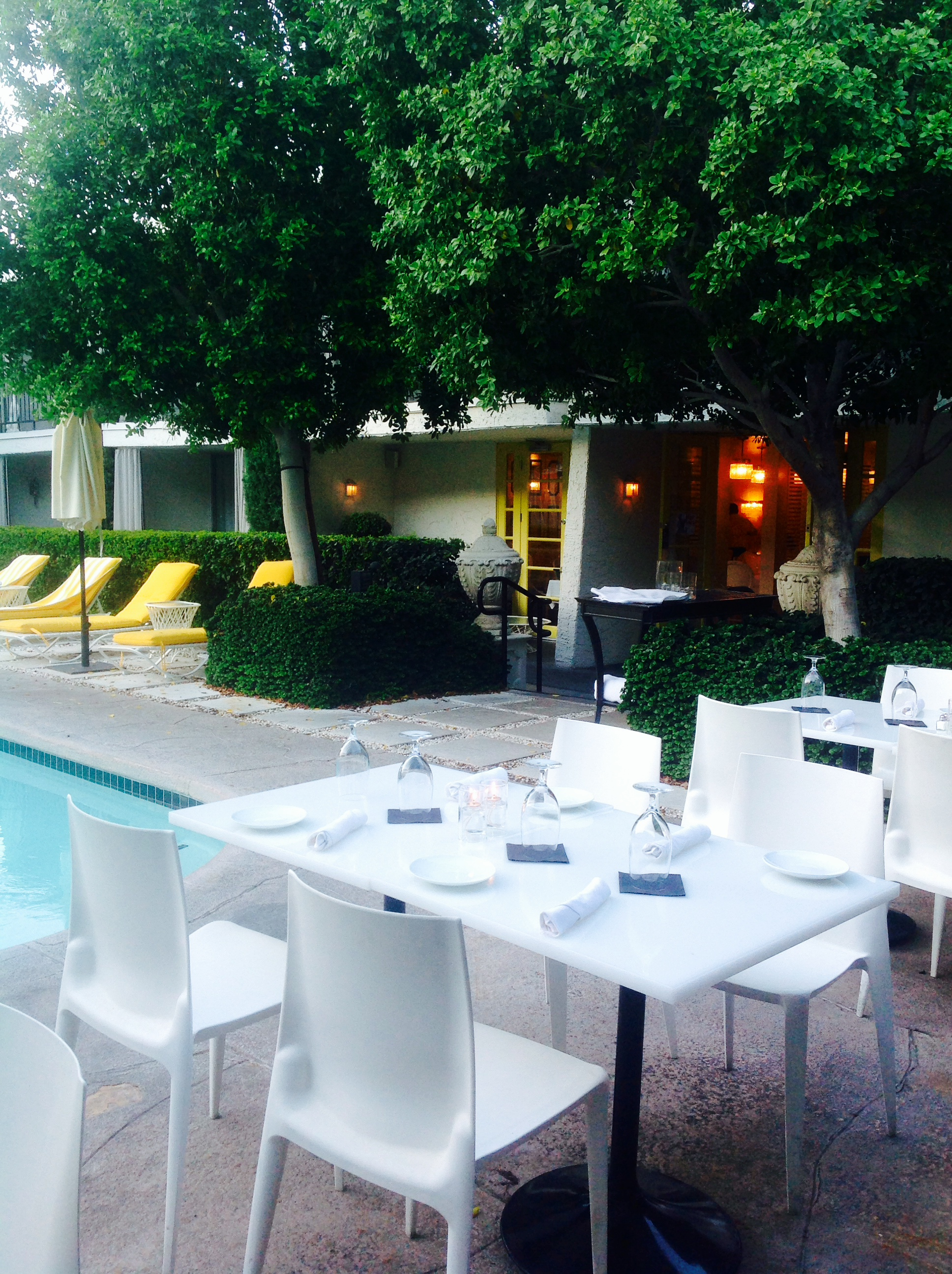 Outdoor seating by the pool.