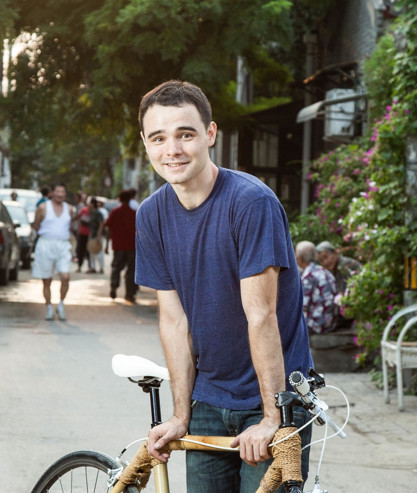 David Wang, the founder and instructor of Bamboo Bicycle Beijing, poses for the photograph in an alleyway of Hutong, a traditional residential area in Beijing, China.