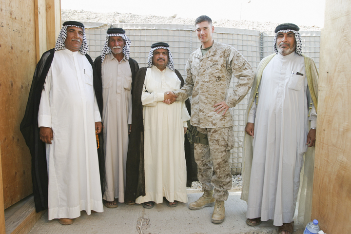 Marine major from Civil Affairs Group poses with sheikhs after reviewing their weapons permits, FOB Iskan, August 7, 2004