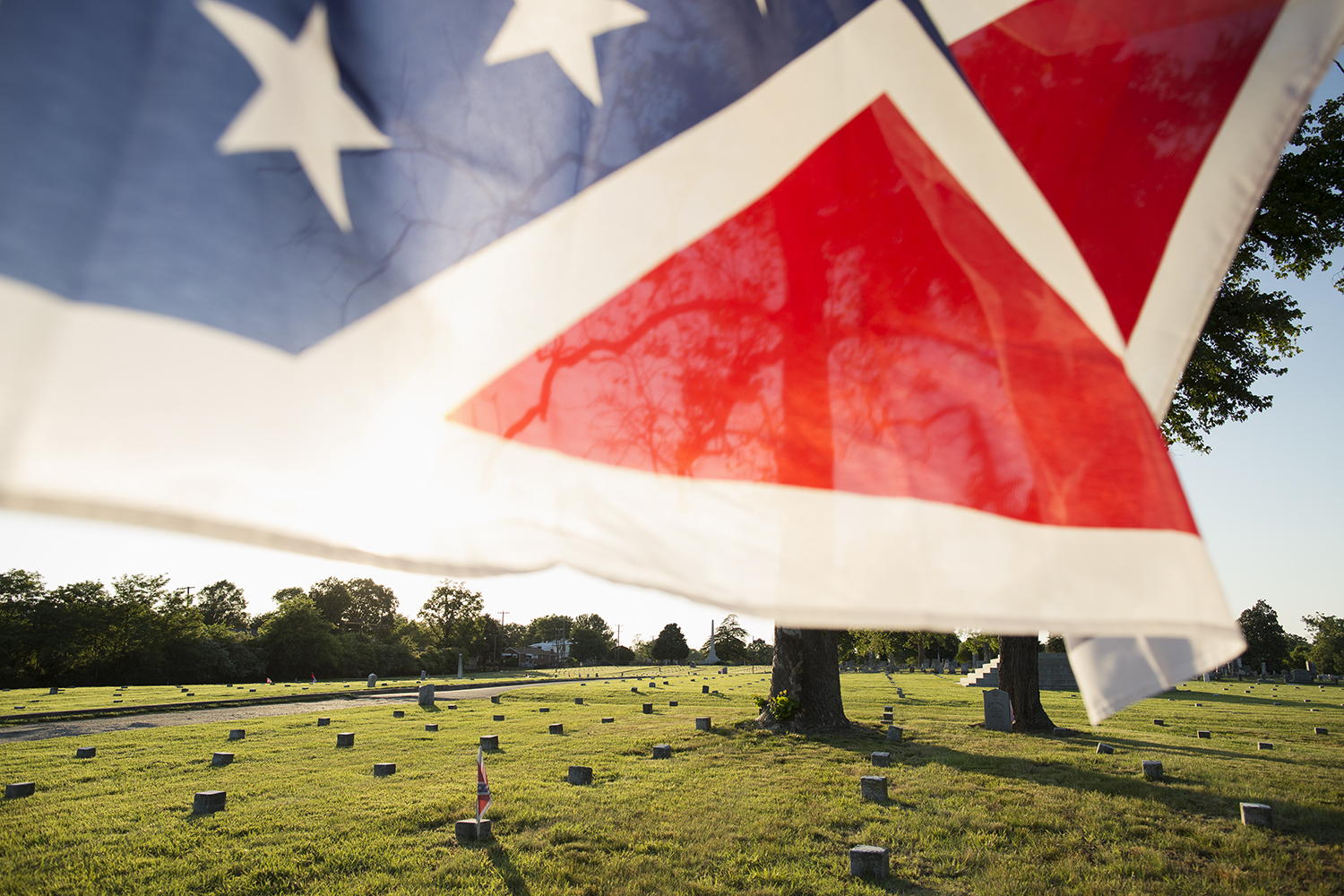 The battle flag of the Army of Northern Virginia flies in the Confederate section of Oakwood Cemetery, which is maintained by both the City of Richmond, VA, and private groups such as the Sons of Confederate Veterans, 2015.