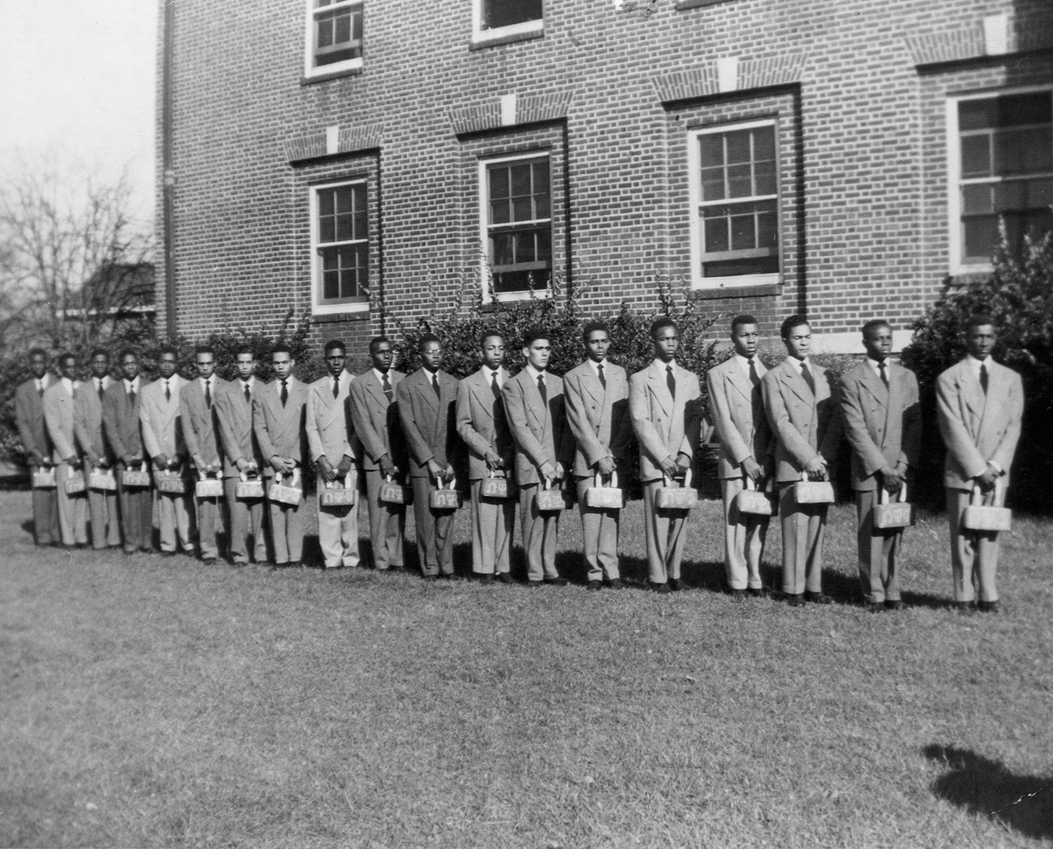 Omega Psi Phi pledges from photo collection of Eddie Palmer. No information accompanied the picture. We are assuming it was taken at Virginia State College (later University) in the late 1940s or mid 1950s. Eddie may or may not be in the photo, among the out-of-focus men at the far left. (Copy photo from original) We welcome help from anyone with information about this image.