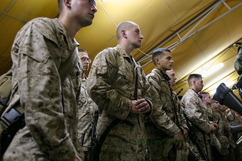 Men of Battalion Landing Team 1/2 (1st Battalion/2d Marines) listen to brief by Major General James N. Mattis, commanding general 1st Marine Division and Multi National Force–West, Camp Virginia, Kuwait, 9 July 2004