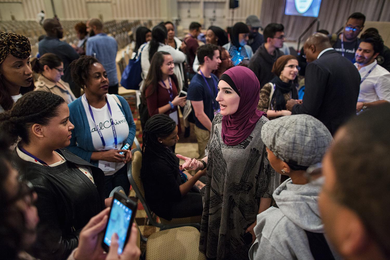 Linda Sarsour speaks to conference attendees after Facing Race 2016 plenary session, Atlanta, GA, 12 November