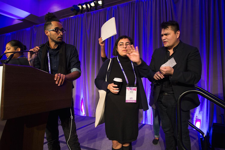 Protesters take the stage to express opposition to keynote speaker Jose Antonio Vargas ( Define American ) at Facing Race 2016, Atlanta, GA, 11 November