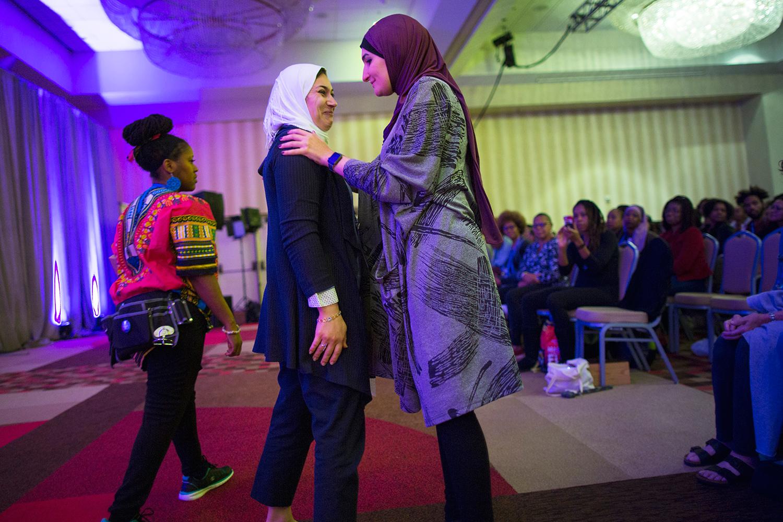 Linda Sarsour ( Arab American Association of New York ) speaks to Dr. Enas Alsharea after the doctor addressed attendees of Facing Race 2016, Atlanta, GA, 12 November