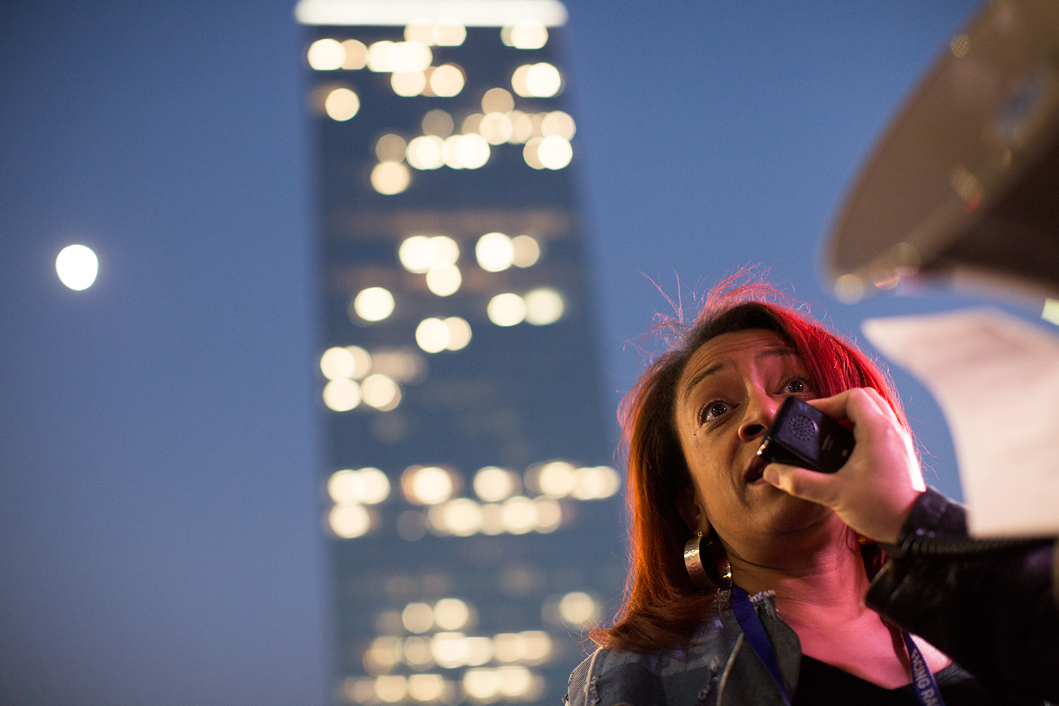 Woman speaks at anti-Trump/antihate racial justice rally across the street from CNN Center during the Facing Race 2016 conference, Atlanta, GA, 10 November