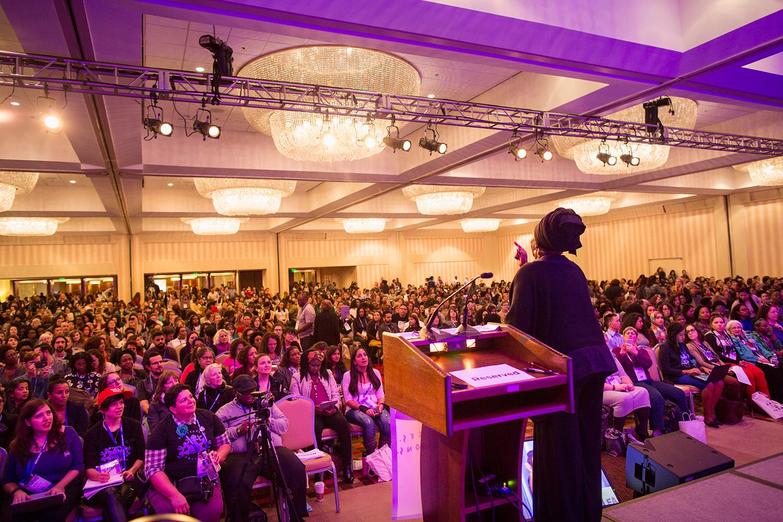 Soyinka Rahim, conference weaver, opens the day's events at Facing Race 2016, Atlanta, GA, 11 November