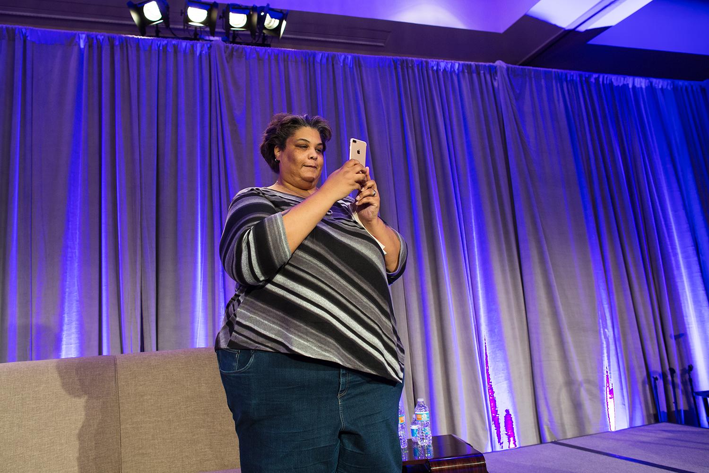 Keynote speaker #1 (of two)  Roxane Ga y photographs the audience at Facing Race 2016 for her mom, Atlanta, GA, 11 November