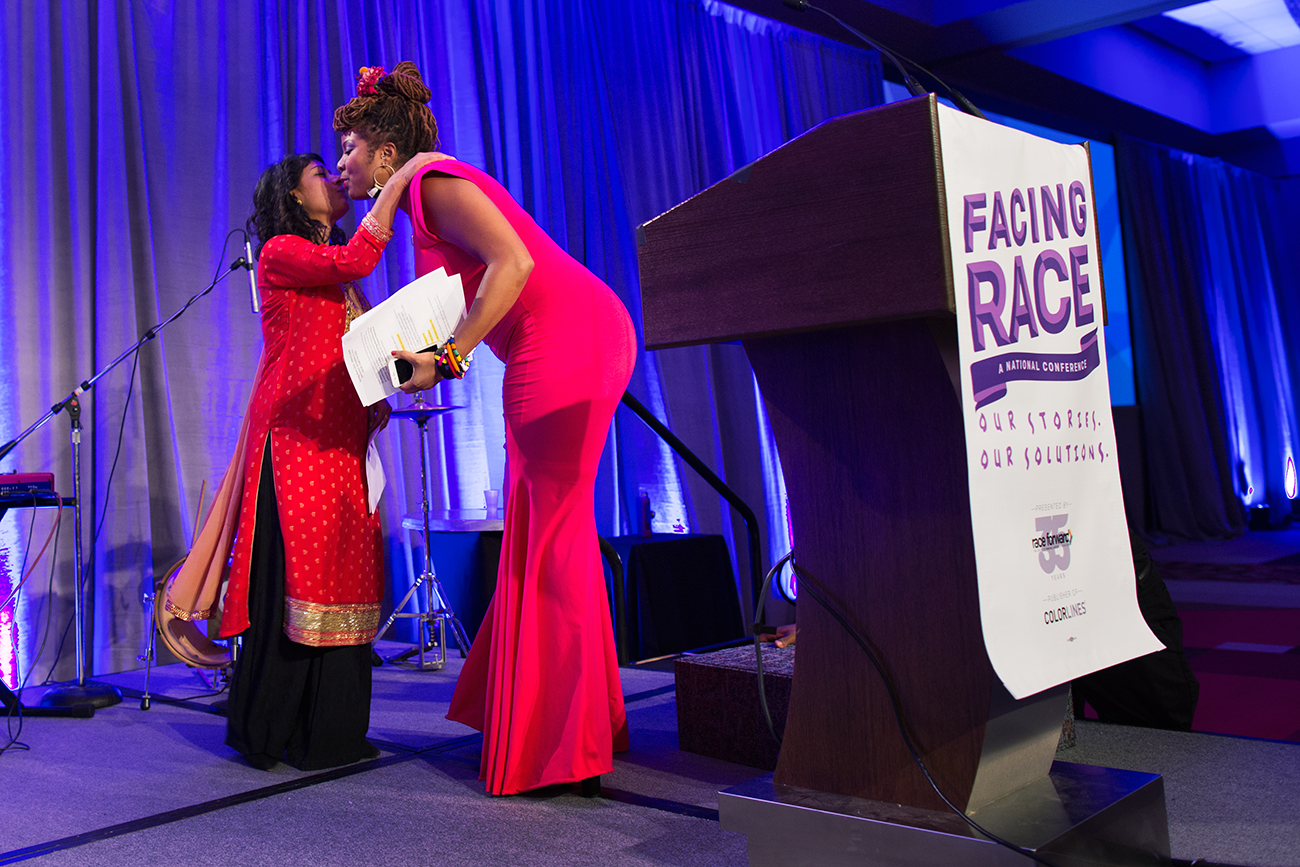 Rinku Sen, executive director of Race Forward, convenor of the Facing Race 2016 racial justice conference, greets emcee  camil williams  before leaving the stage to her, Atlanta, GA, 10 November