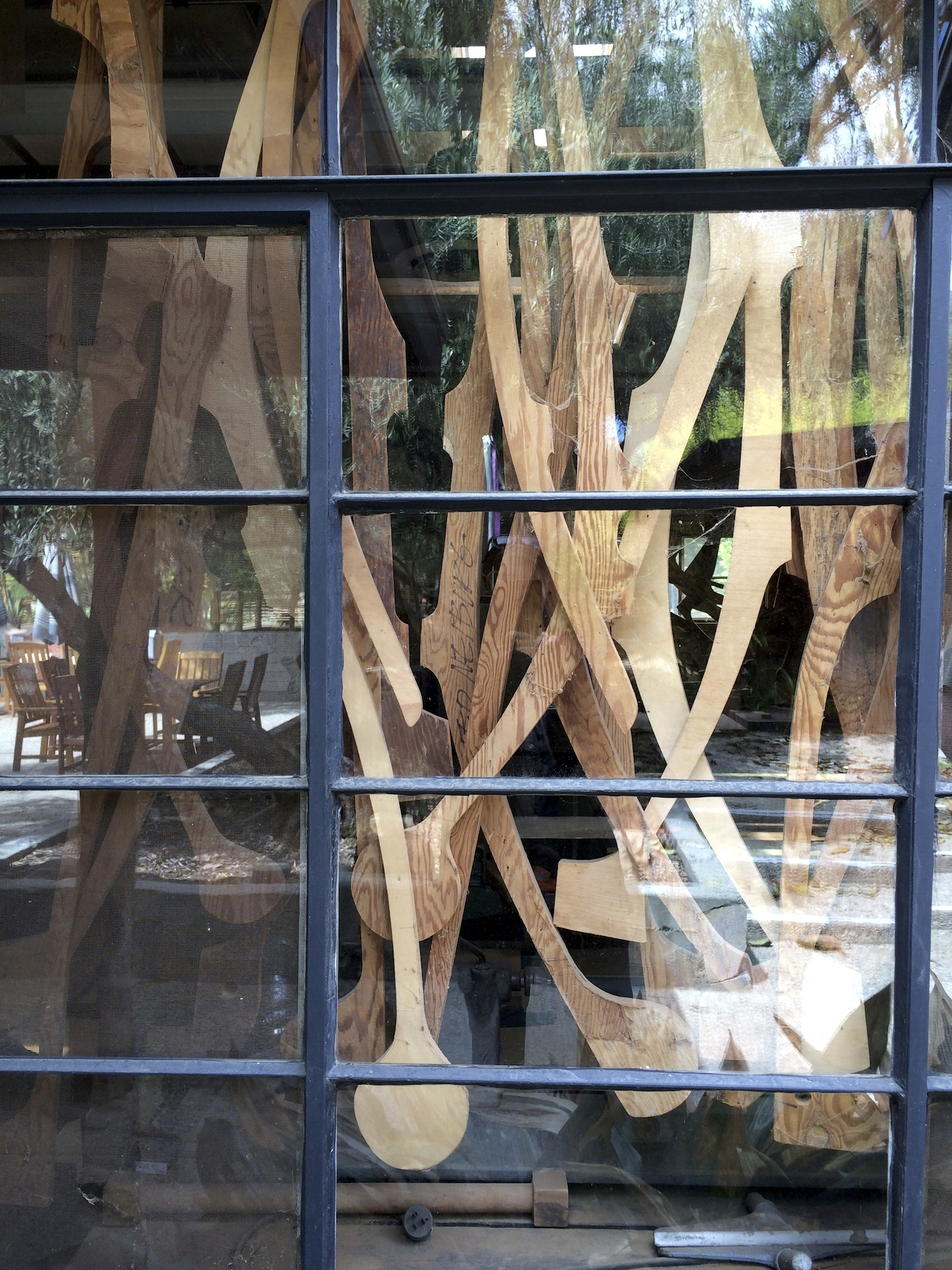 A view of the patterns hanging in the workshop window.