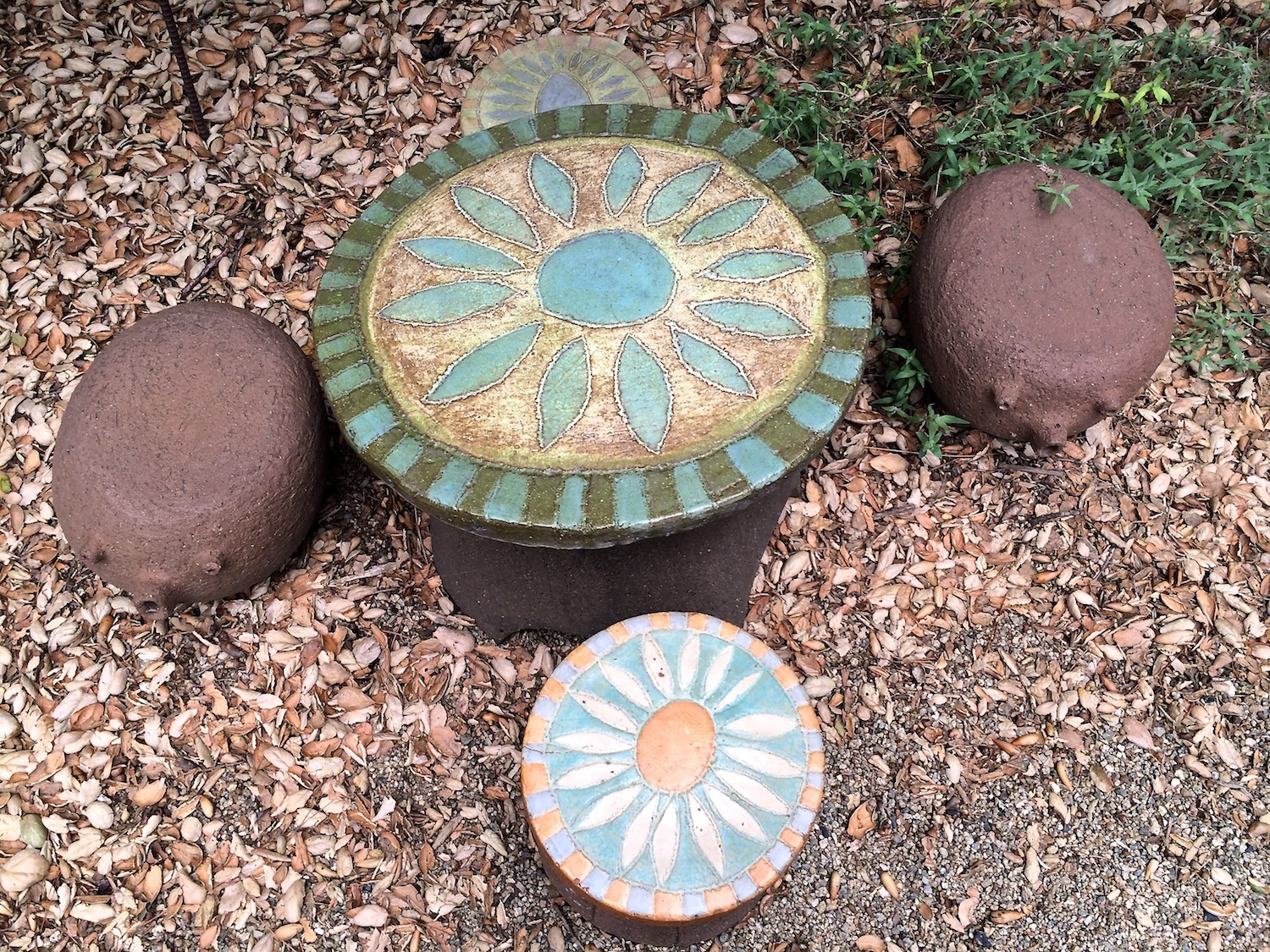 A vintage flower table and stools accompanied by Stan's whimsical animal stools.