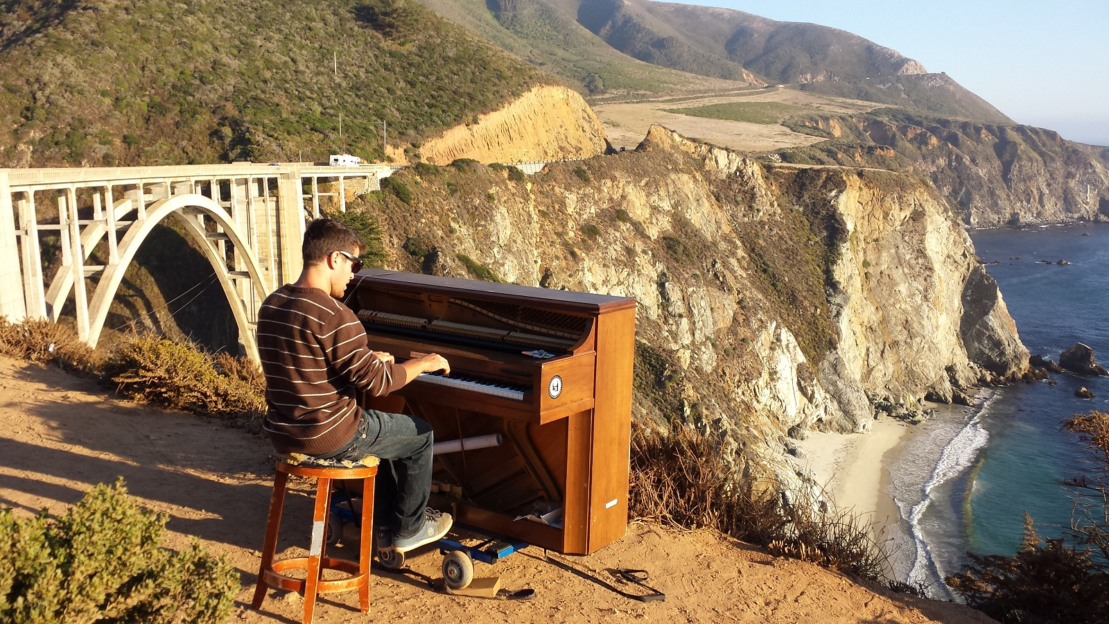 playing piano at big sur on the edge