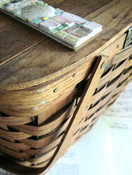 I love the vintage shell detail on this basket.  Perfect for beach picnics!