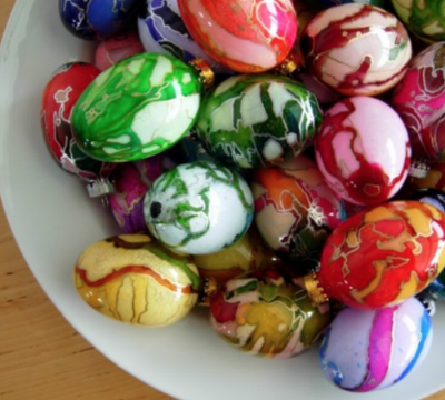a rainbow of hand painted eggs from Schemata on Etsy