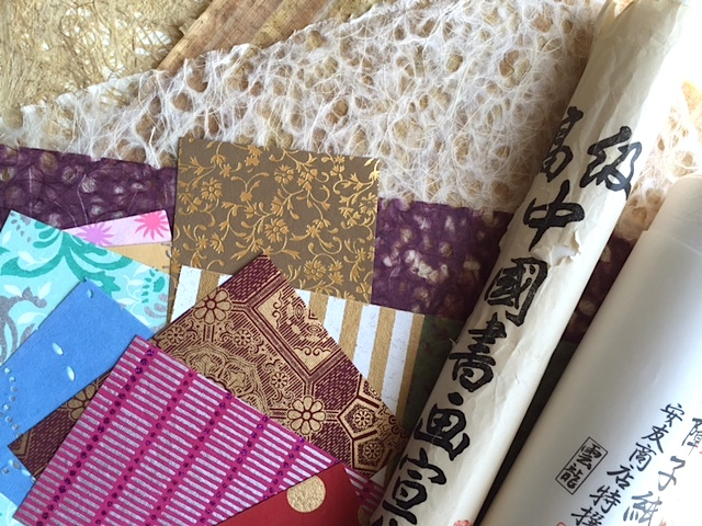 Assorted handmade papers: Japanese lace, rice paper, washi, bark,and Egyptian papyrus.