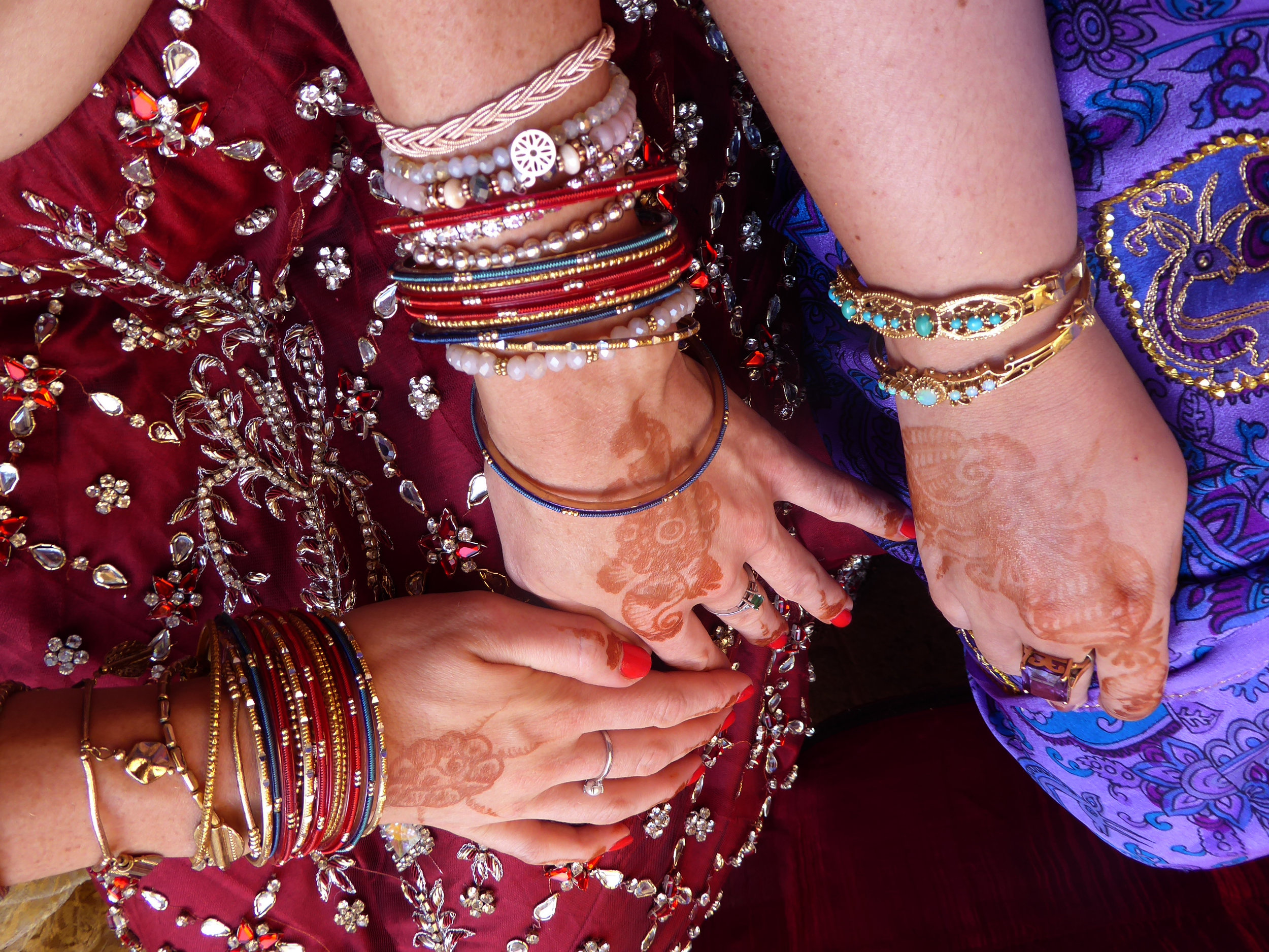 Henna and bangles galore! I loved all of the sequins and embellishments on everyone's wedding attire.