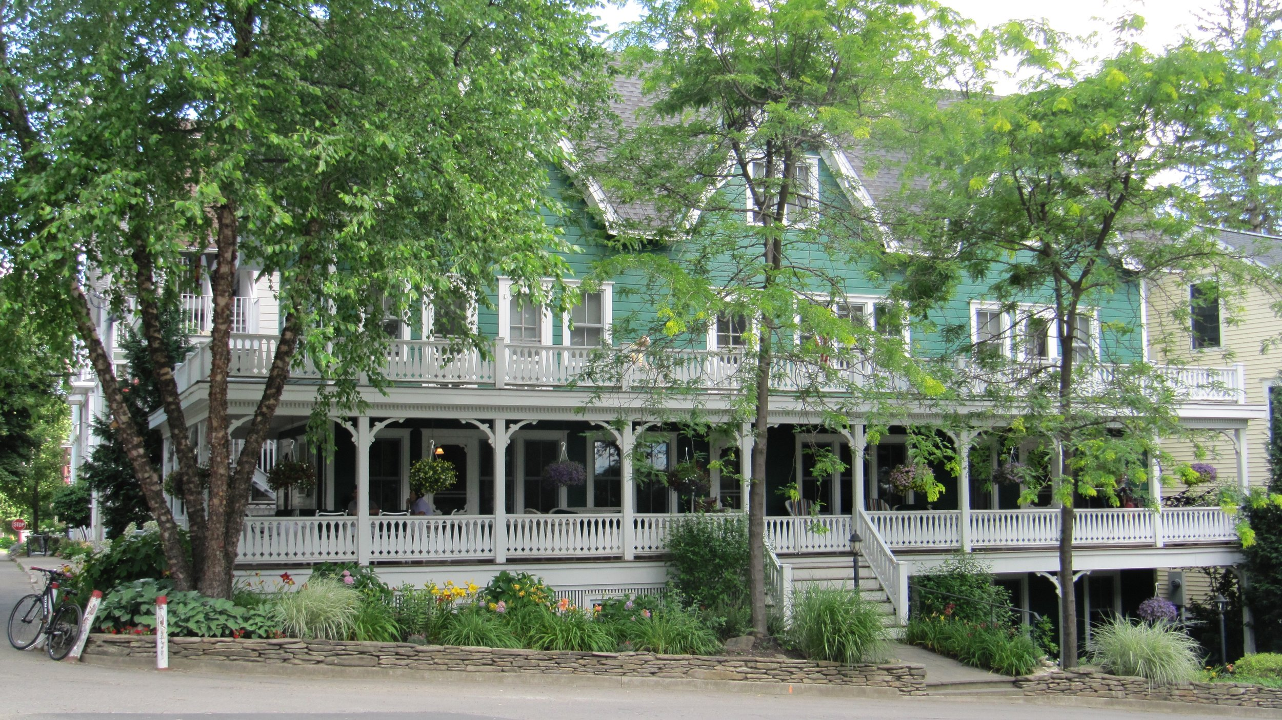 This splendid green and white new Victorian has porches that never end and is near the amphitheater.  The architect did an amazing job with an awkwardly narrow and hilly spot.