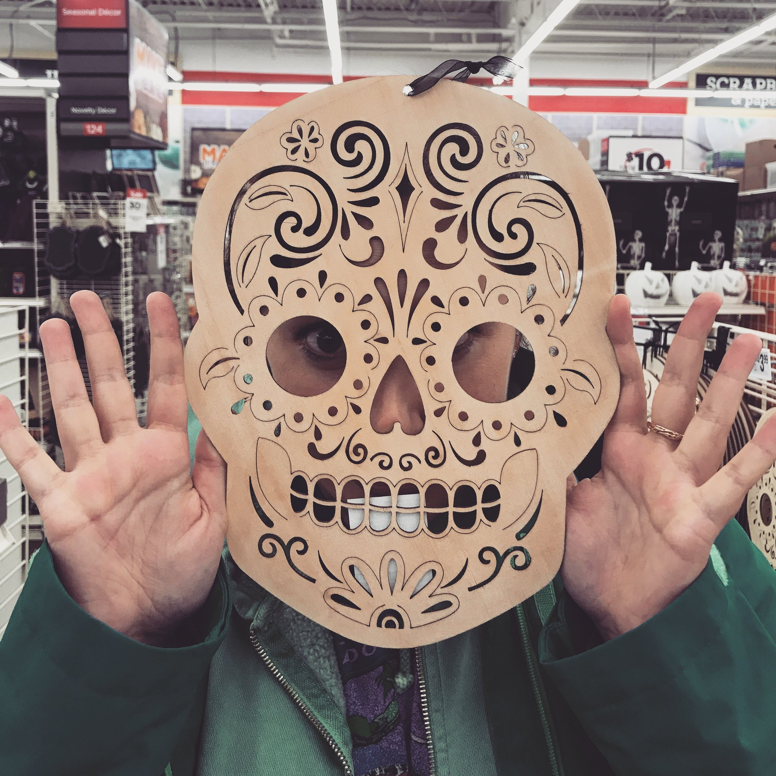 (Dia de los muertos symbols have become so widespread that even craft stores sell ones you can decorate yourself)