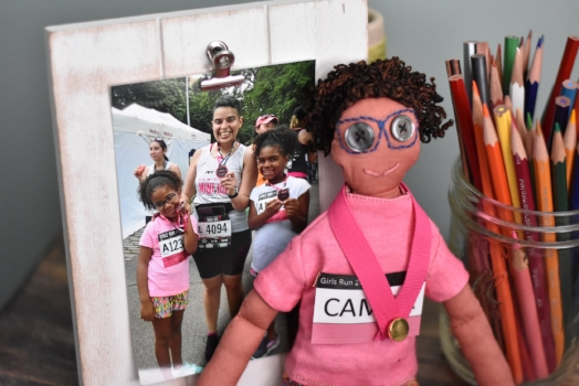 """My name is Raquel. I just joined the team this February. My Etsy shop is  www.maquina37.etsy.com  and I specialize in making cloth doll caricatures of people. I also make quilts and greeting cards. A doll that is custom made to look like someone sends the message """"I love you, just the way you are."""" I would love to share the story of two women who have inspired me.       My mom was 26 when she came to the United States from the Dominican Republic. She had six children and was a widow. She also started working in factories (sewing) to make enough money to bring her children over one by one. She met my father, was remarried and had me. All seven children grew up together. But unfortunately, my mother was widowed a second time when I was ten. Despite all the sorrow she has faced, she keeps going, and she is always happy and graceful. She recently retired at 69 years old. She is now taking English classes, traveling and enjoying life.       The other woman who inspires me is my wife. My wife is a retired police officer. She joined the police department in the late 80's. She faced a lot of discrimination for being a woman and for being a lesbian. Despite the hardships she faced, she lived openly and had a successful career. I feel in love with her strength and courage. I asked her to marry me in 2014. We were married in August of that year. And in 2016, she was diagnosed with breast cancer. That same year, I ran the New York City Marathon and dedicated the race to her. At the finish line, a read this little speech I had prepared, """"....Whenever I doubted myself, you were my confidence. And, you were always honest and nurturing. Over the last few months, you were struggling with your own race. And still, even when you weren't feeling good, you always managed to put us first. You were always selfless. You taught me that 'life is tough my darling, but so are you.' You were my strength...I dedicate my run to you. All 26.2 miles for my wife."""" I gave her a necklace with the pend"""
