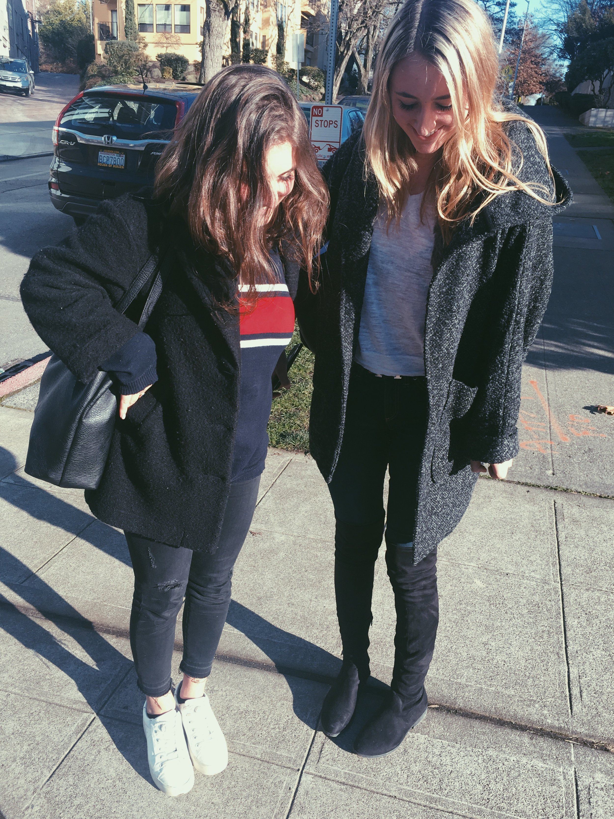 Ruby '17 and Camille '17:  This duo proves that layering is key. Ruby goes with a sporty approach in an American Apparel coat, Brandy Melville sweater, Zara jeans and Steve Madden sneakers. Camille chooses an Urban Outfitters coat, Nasty Gal boots, and Rag & Bone sweater and pants.