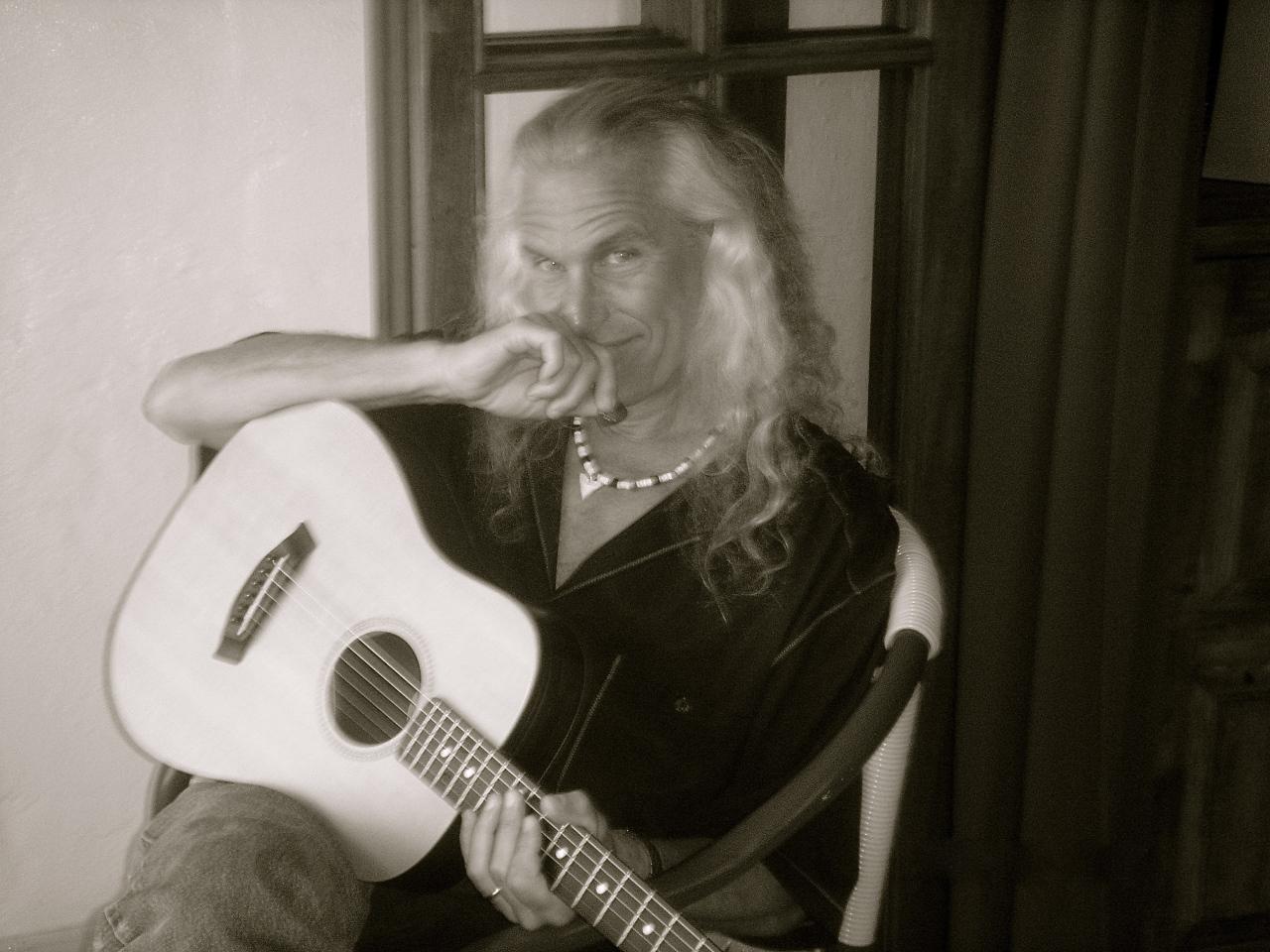 Chick Petersen and his guitar Photo by Deborah Parrish