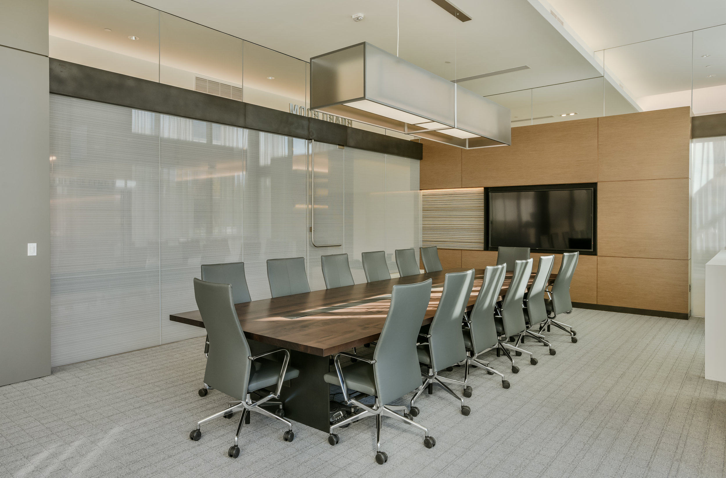 custom maple conference table with steel inlay, data ports & steel base