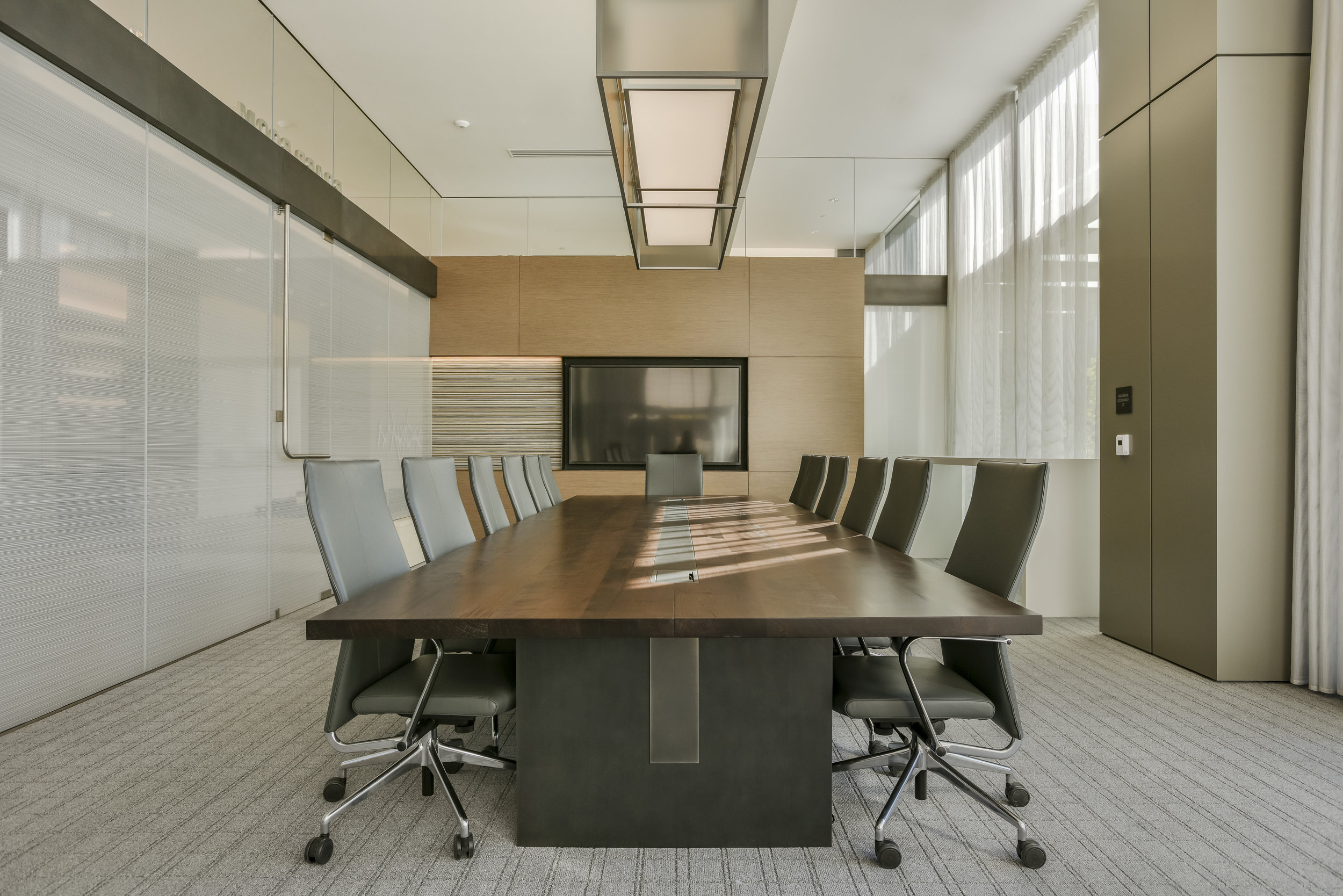 solid maple conference table with data units