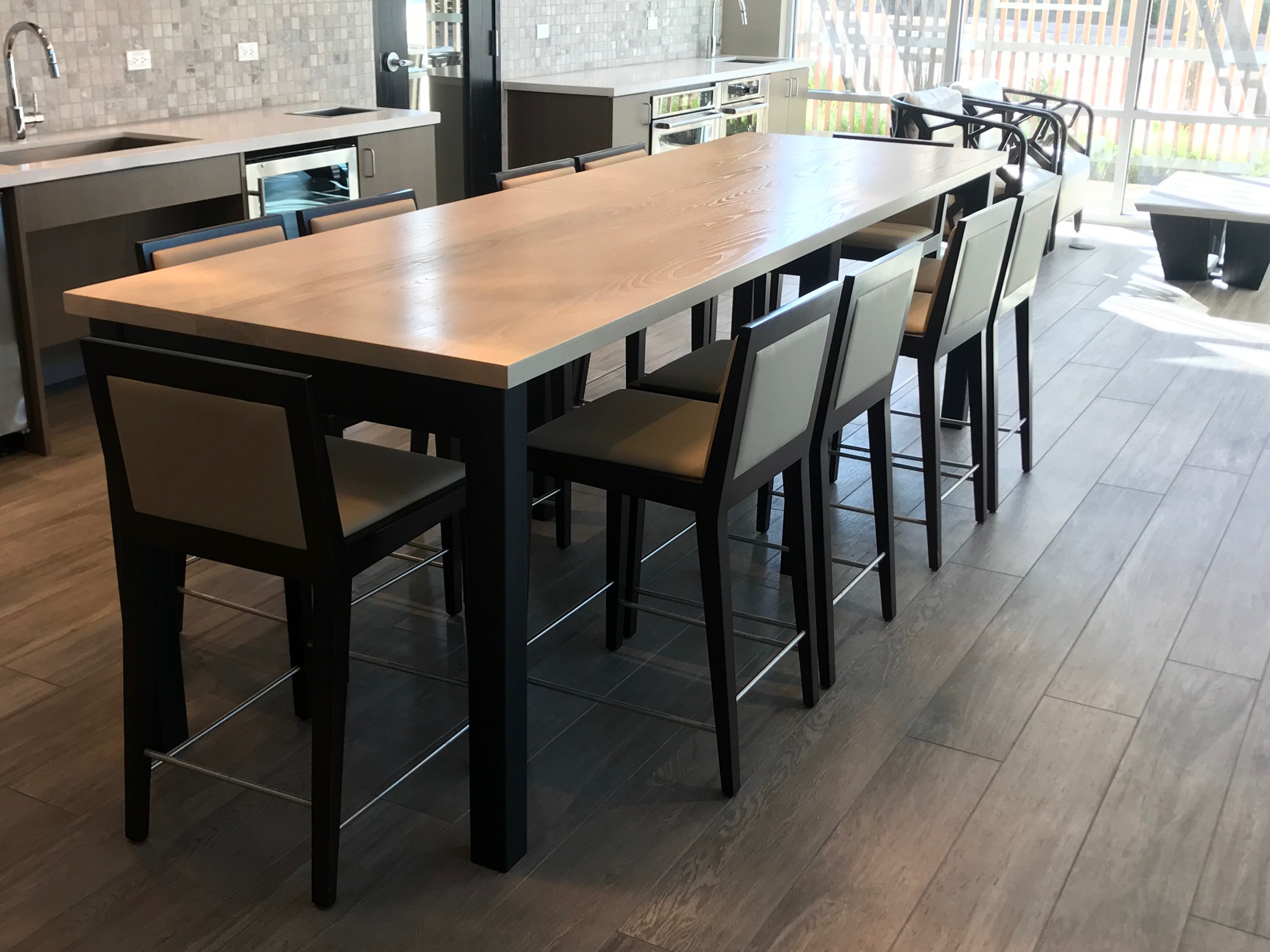Standing height Ash Nelson table in Snow finish with Matte Black Bronze base