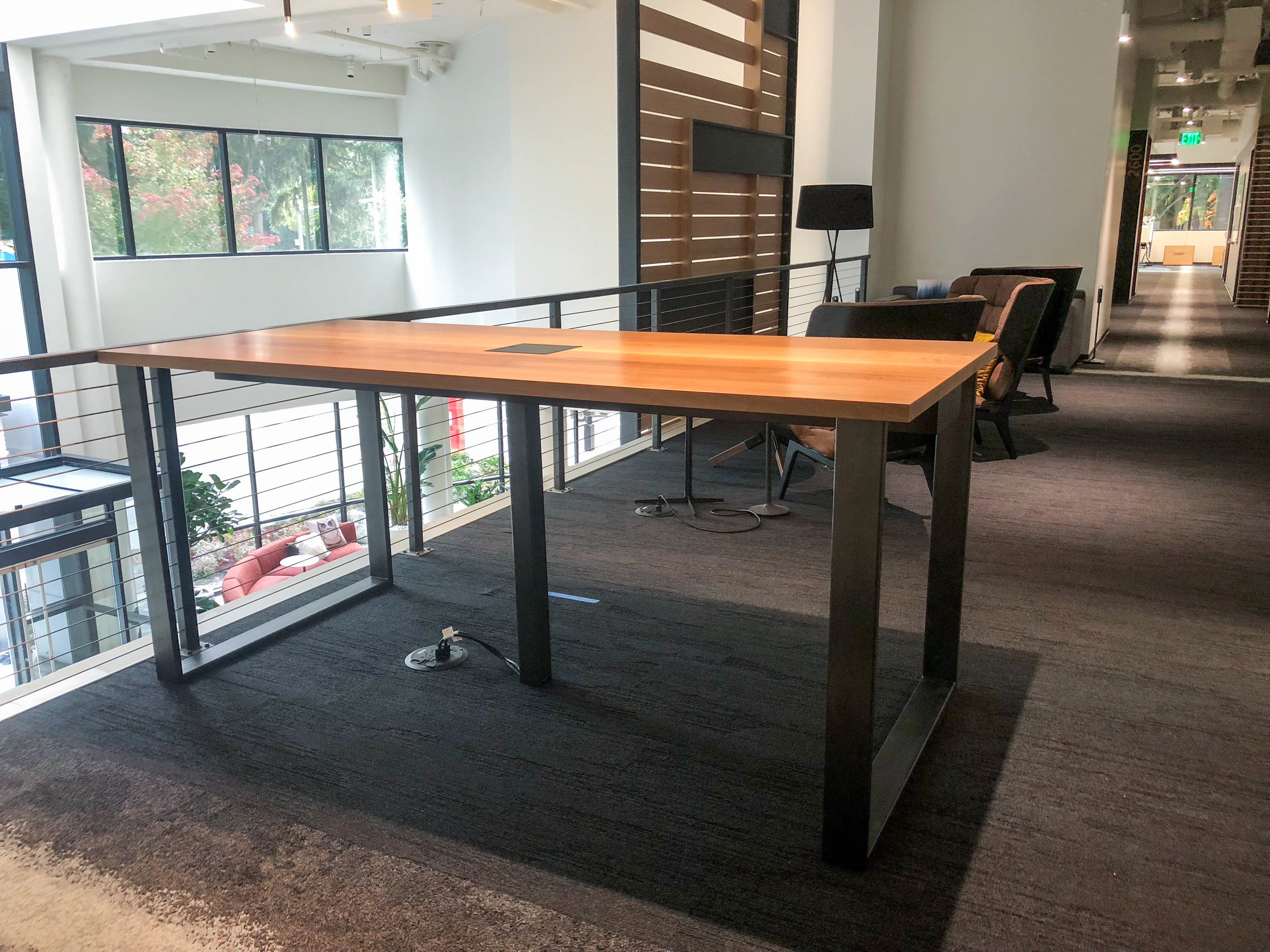 Brower Table in square edge Maple with Clear wood finish; base in Matte Black, INTG1 data unit and center metal data leg