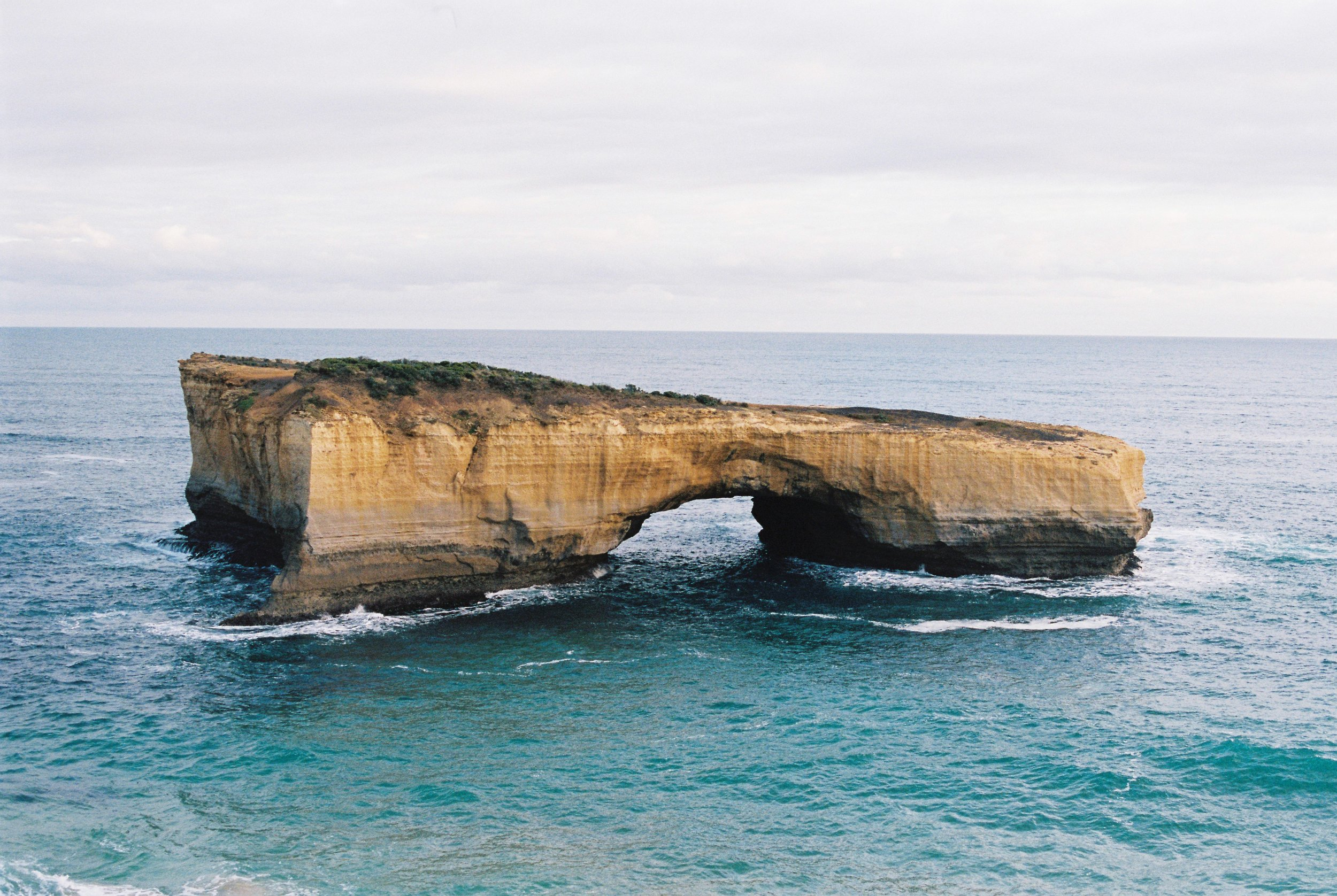 """GREAT OCEAN ROAD - """"I note how bright the water is under a bleak sky. Ultramarine. My hair whips in the wind. Mum says we're going to go get a cup of tea in a café in town. I turn away from the wind, and the world is instantly hushed."""""""