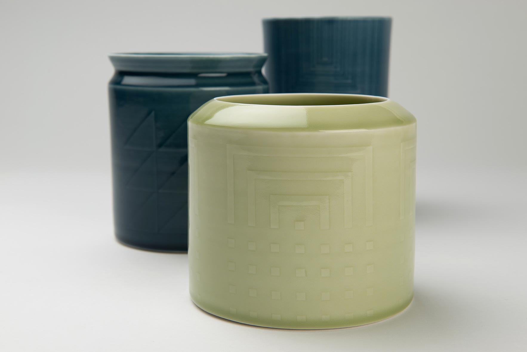 Porcelain vessels, wheel thrown, relief detail   Front 13 x 14 cm  Middle 15 x 13 cm  Back 18.5 x 12 cm