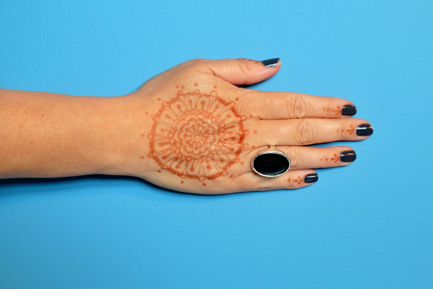 my mums hand with the henna that my clever cousin did, beautiful.