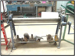 The rollers are used to roll sheet steel, aluminium and light gauge tube or rod. It is controlled by hand and produces a one way shape unlike the English wheel. However it is just as important in the panel making process.