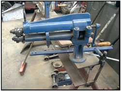The swage tool is used to put reinforcing lines and swages in to panels such as in guards and floor panels. It is hand operated and needs two people to work the machine neatly.