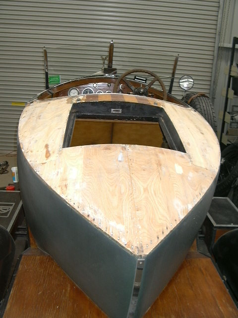 The old veneer was removed and new, thicker timber was cut and bent to fit the boat tail. Glued and clamped in position with a two pack marine grade adhesive.
