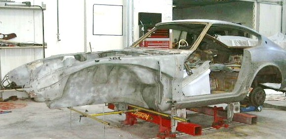 The Datsun 240Z was stripped down by the customer before it delivery to the workshop. The Datsun had accident damage to the radiator support panel and the inner tower. The Inner skirt also needed work to align. The body shell was setup on the chassis measuring equipment.