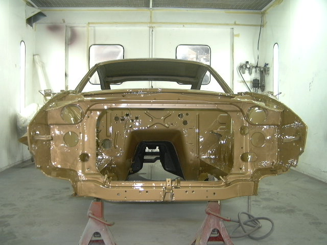 The body shell was straightened and pulled into alignment. The doors, bonnet and front guards were also checked for alignment throughout the pulling process. The body shell was completely stripping down further with the underside having stone-guard sprayed like the original factory finish