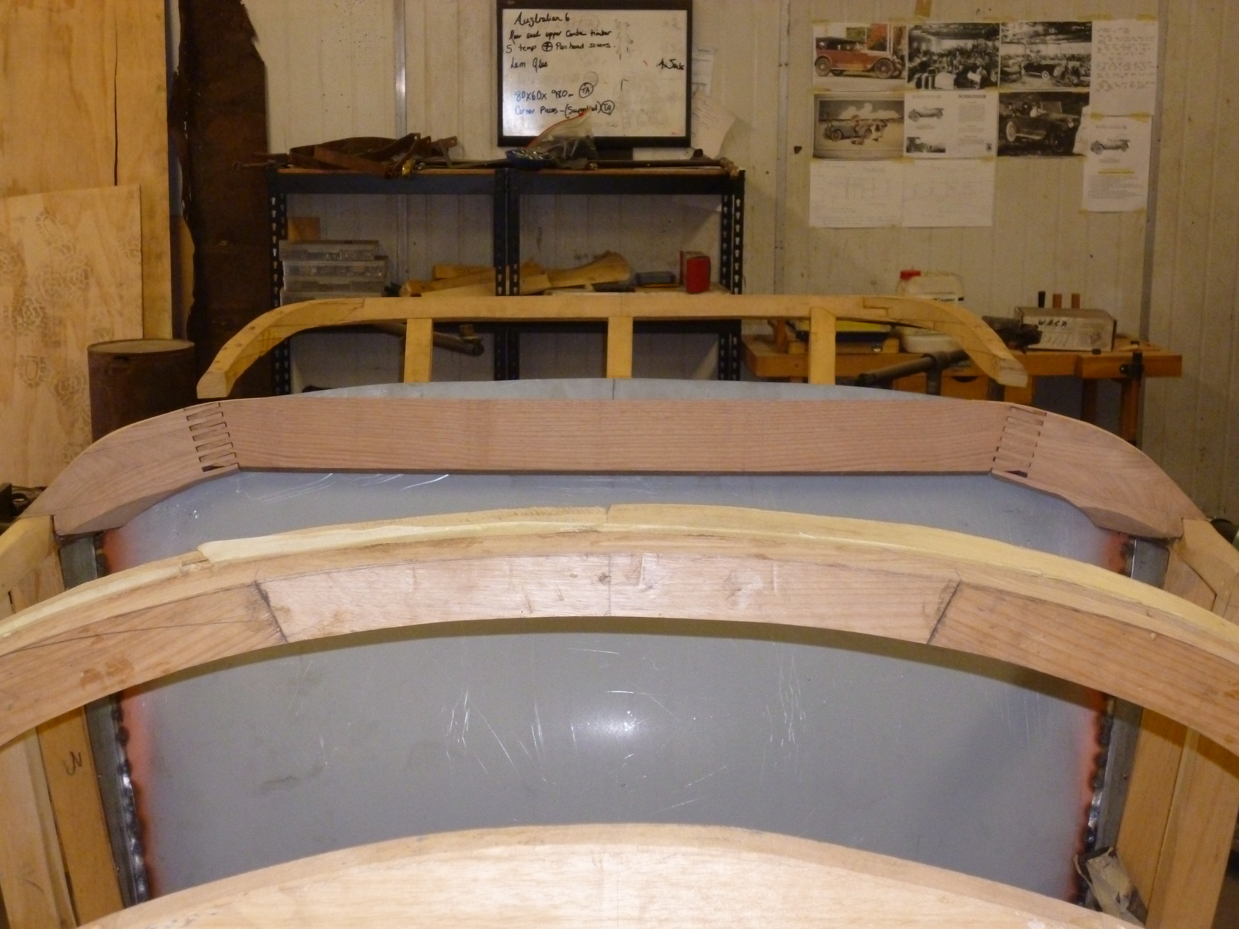 Period joints have been used in the new timber frame including finger joints. The joints are rough cut and then finally fitted and shaped. The front seat panel acts as a brace and as a pattern. The second group of photos show the new sections of the timber frame being built.