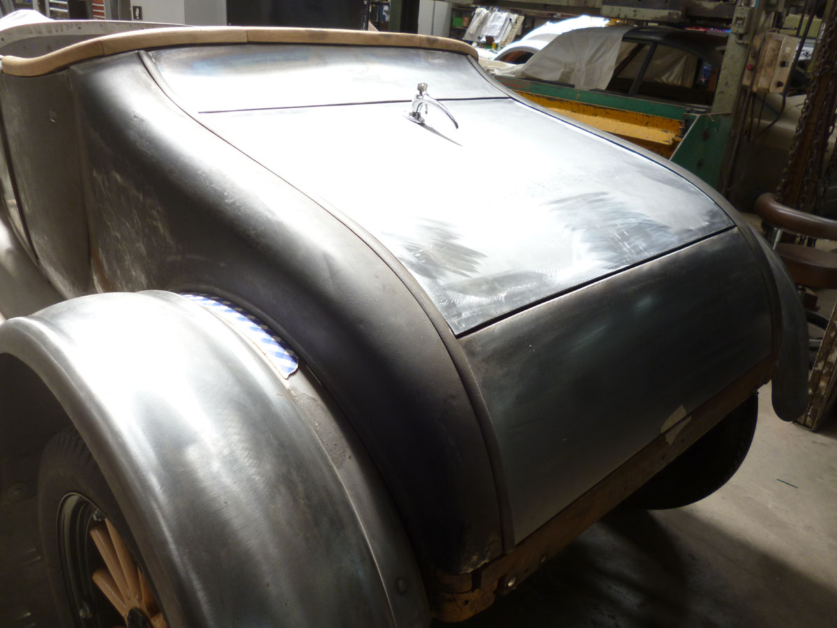 The rear boot lid and boot space has been converted to a Dickie seat. The body panels have been locally repaired and filed finished. The original timber wheels have been stripped down and the rims and wheels have been sandblasted. New timber spokes have been installed into painted wheel assemblies.