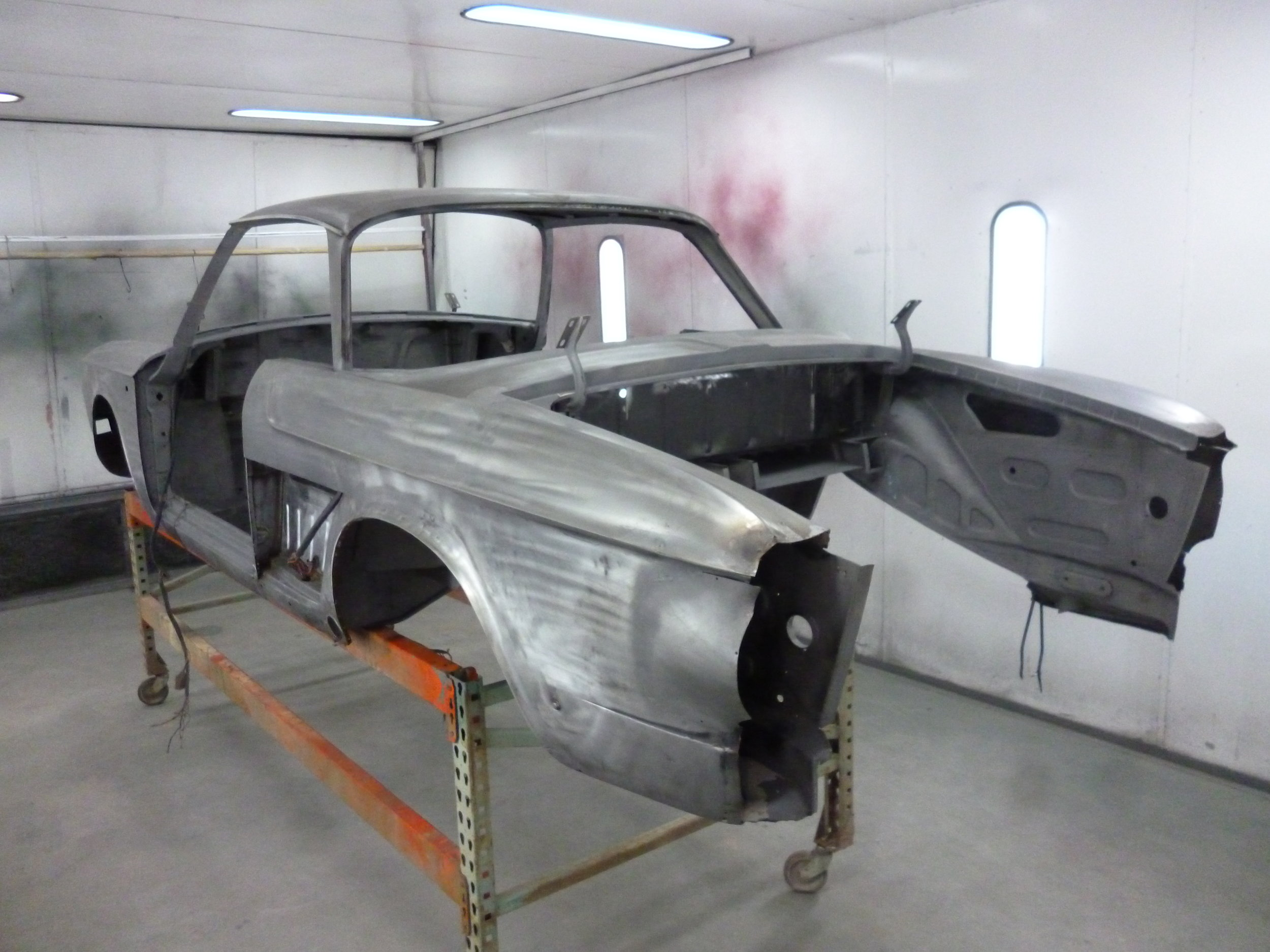Rear of the body shell. The engine bay has been removed prior to deleivery. The engine bay has been rebuilt using a donor car and NOS panels.