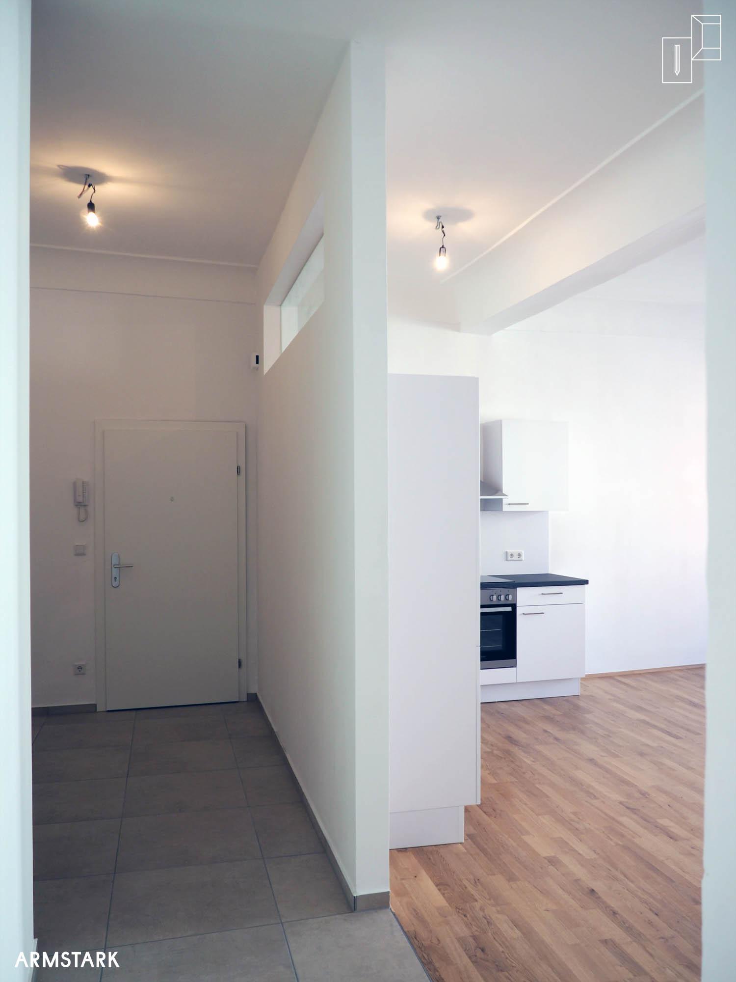 Altbau saniert von Armstarkdesign_2016_04-Vorraum-Küche.jpg