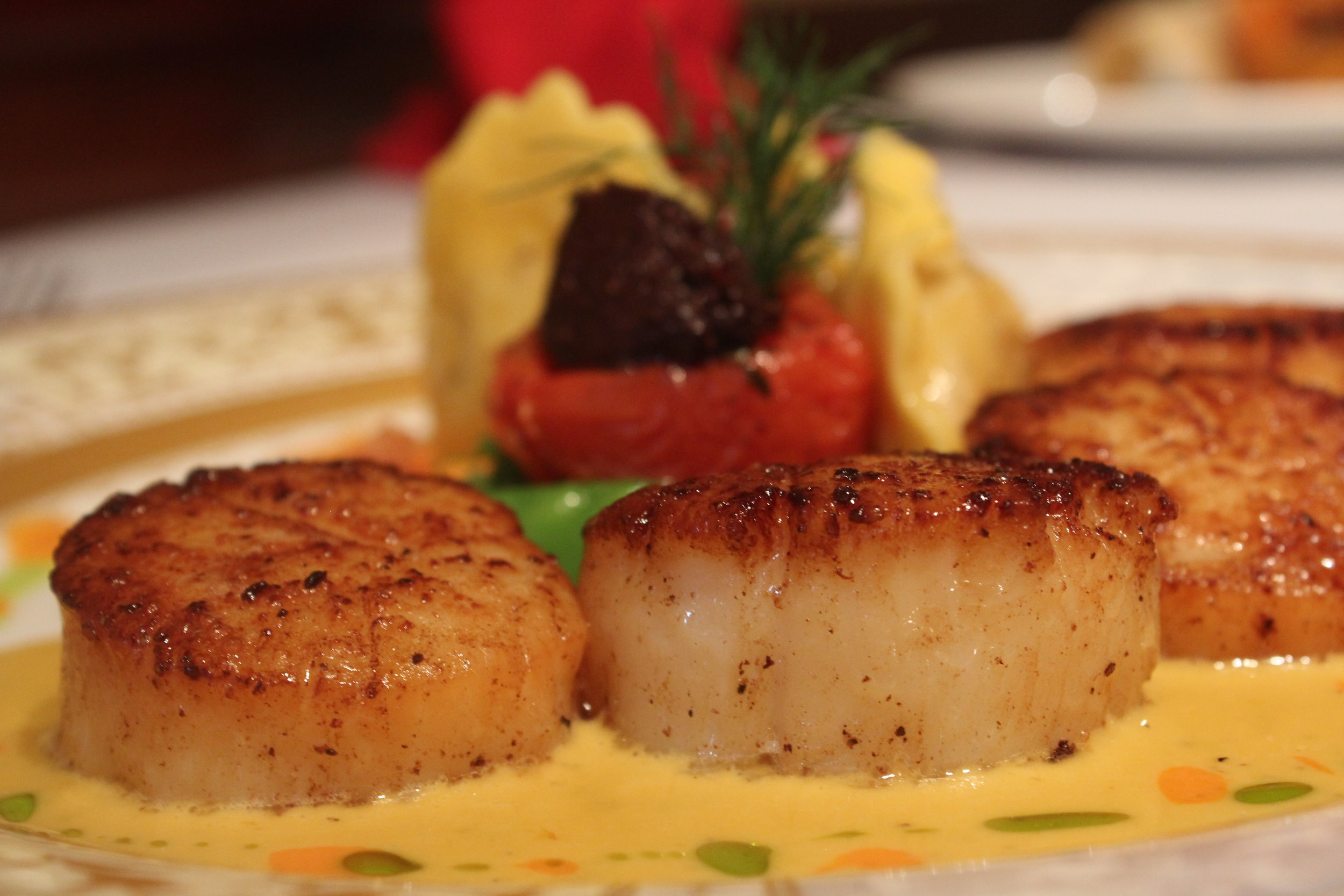 Close up of Scallops with other items blurred out.JPG