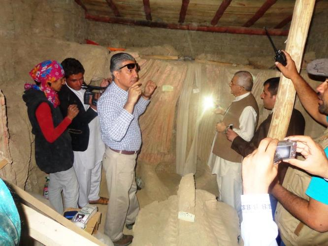 Photo Opportunity: Afghanistan's Minister of Mines and Petroleum Daud Saba, standing in front of a Buddha statue and surrounded by cameras at Mes Aynak.